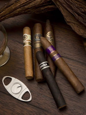 five cigars with cutter